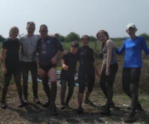 Band members running the Wimborne and Ferndown 5K Muddy Fun Run