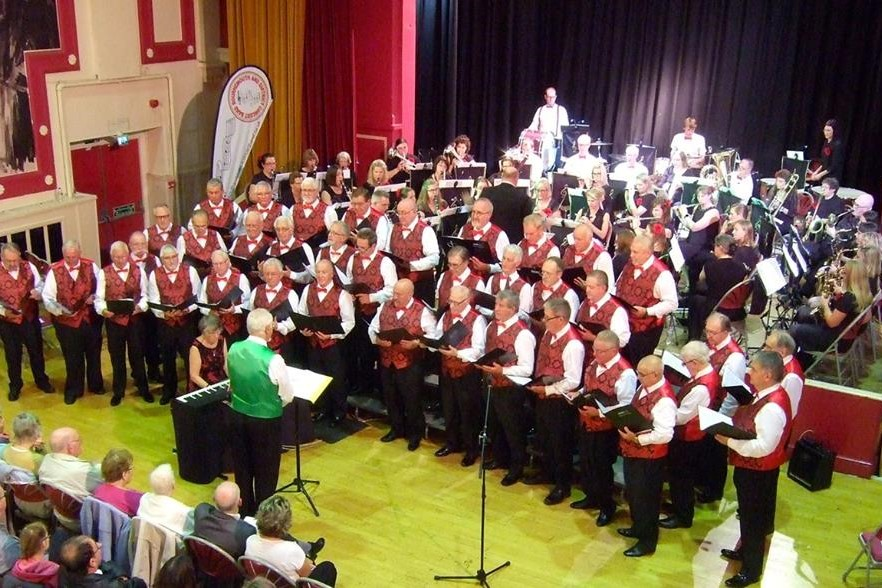 Band and choir performing together