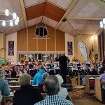 Audience listening to band play at autumn concert