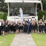 Band members standing in front of Bournemouth bandstand