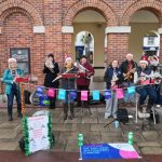 Band busking Saxon Square Christchurch contributing to money raised for Cancer Research UK