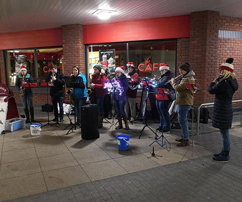 Band busking outside Tesco