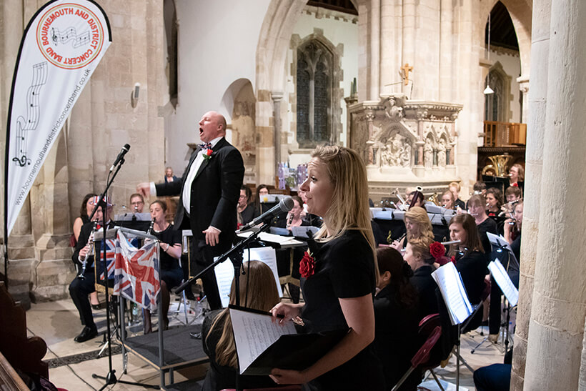 Our singer and conductor performing with the band in Wimborne Minster