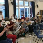 Our brass and percussion section at band rehearsal in school hall