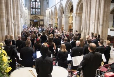 View of band and audience at concert in Wimborne Minster
